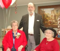 Ruby Caldwell Dunlap is shown with her daughter Joyce Fitzgerald and her son Norman Dunlap during her 100th birthday celebration.