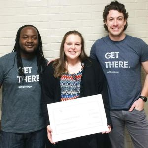 Lindsay Sappington (pictured center), a New Albany High School senior, was surprised in her classroom at NAHS with the news that she is a $1,000 winner in the Get2College Scholarship Competition. The money will go to the college of her choice. Making the presentation were Stephen Brown and Austin Deskewies from Get2College, Mississippi's nonprofit resource for free college planning. Brown rapped a song about Lindsay, and Austin threw Pay Day candy bars to her classmates to demonstrate that applying for scholarships can pay. There were more than 3,000 entries in the competition that required students to write mini essays on how they chose the colleges to which they applied and how they envision seeing themselves a year from now as they complete their freshmen year of college.