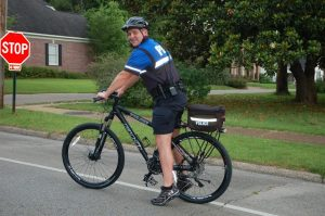 NAPD Officer Stuart Dodds is shown riding one of the new police bicycles on New Albany's Main Street