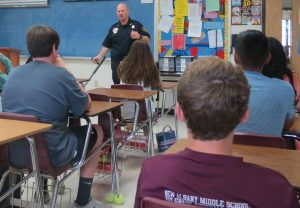 Police Chief Chris Robertson talks with students