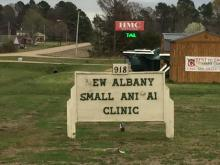 deteriorated vet clinic sign