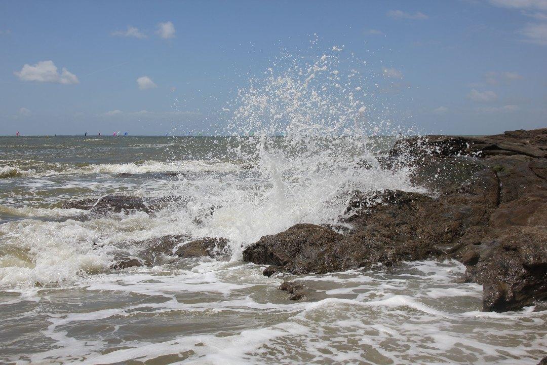 The impressive sea crashing on the rocks