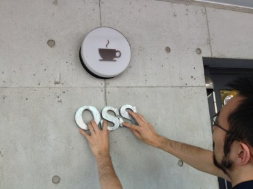 OSS under coffee cup