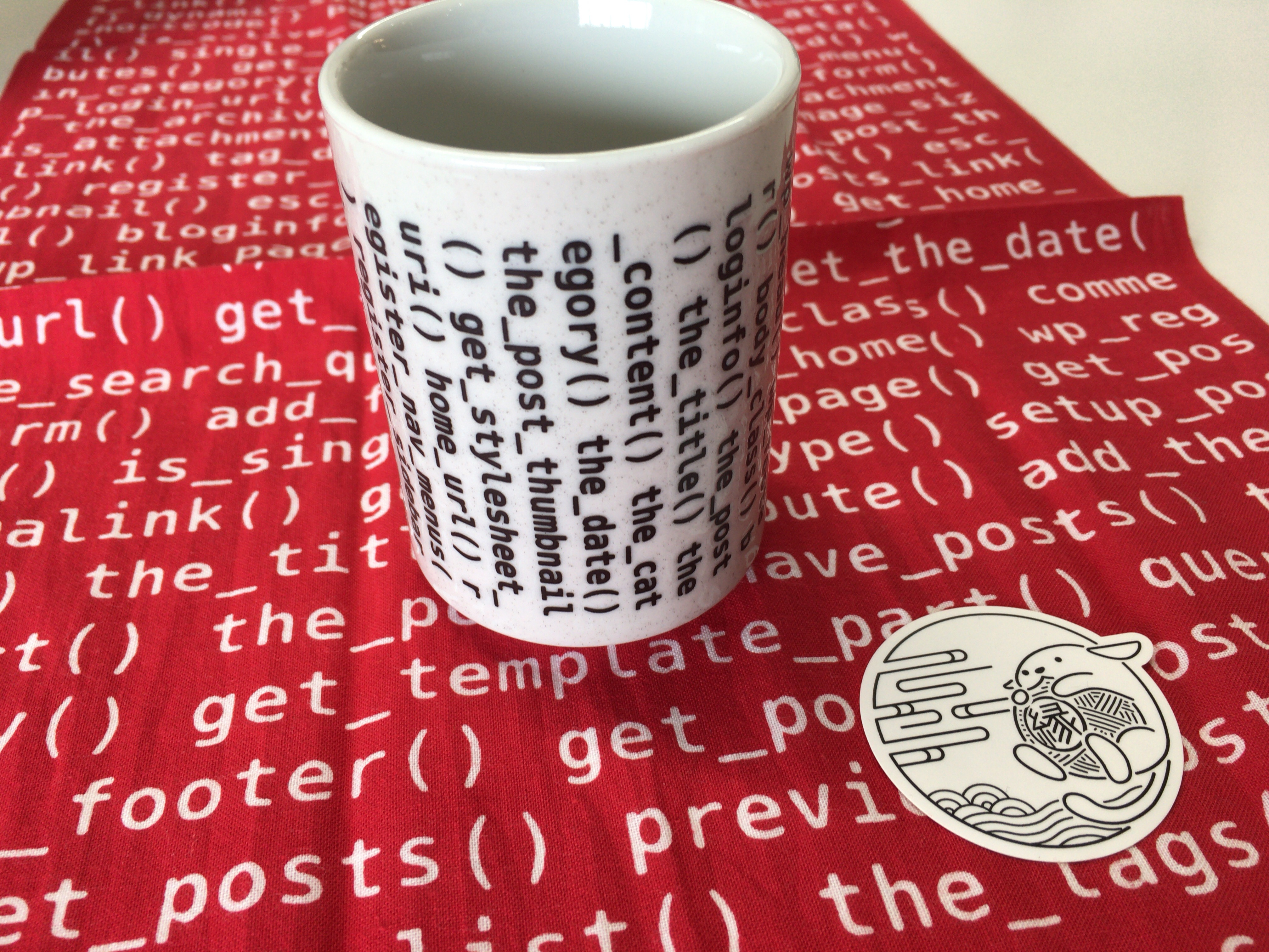 WordCamp Kyoto swag: tea cup, tenugui, & sticker