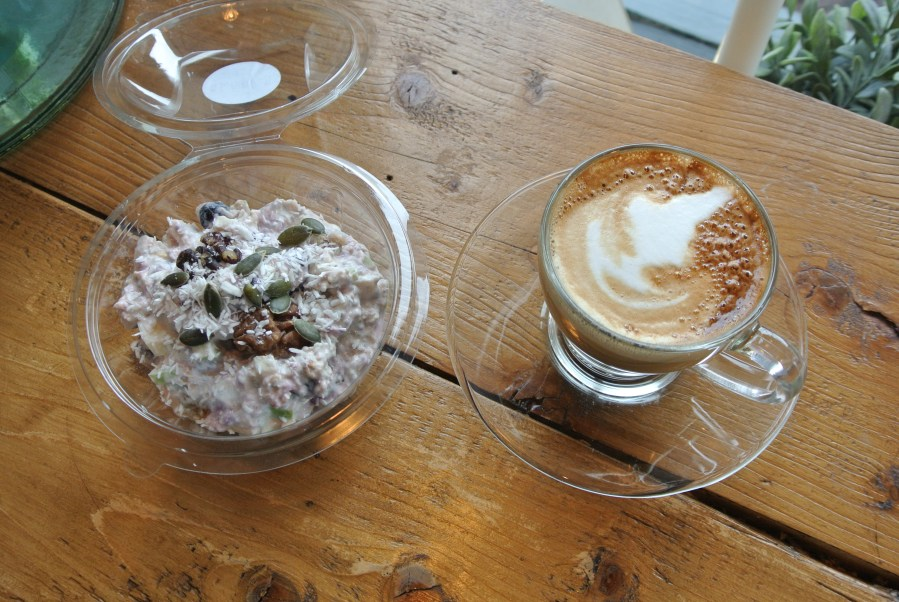 Perfect breakfast combo of muesli and a cappuccino.
