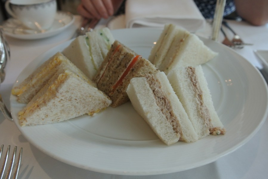 Selection of finger sandwiches: tuna mayo, smoked salmon and cream cheese, cucumber and cream cheese, egg mayo and chives, and turkey ham and chicken.