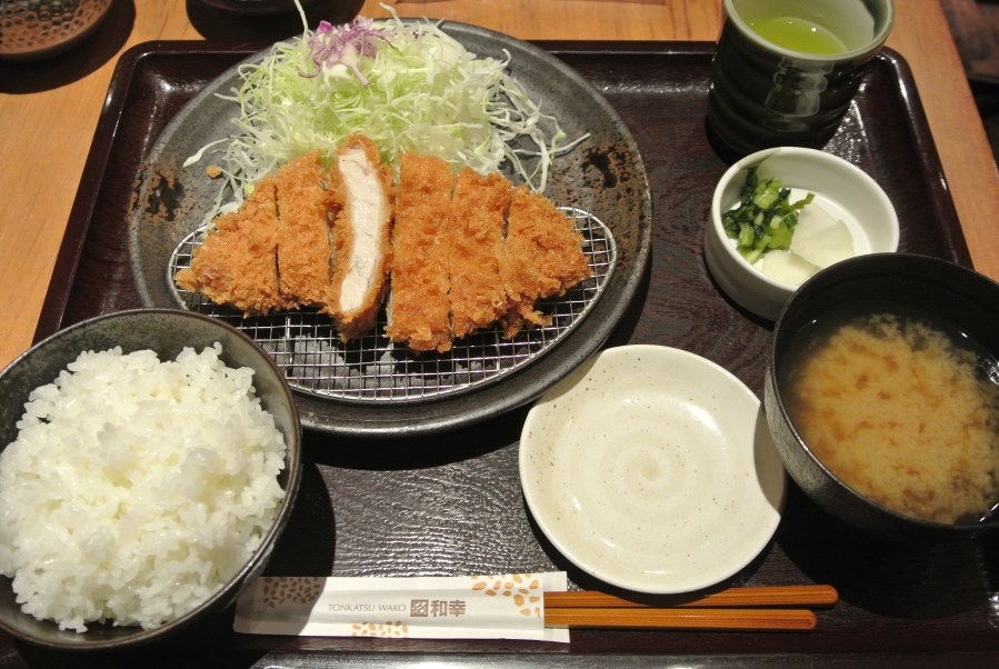 My dinner set featuring the pork tonkatsu, a side of raw cabbage, miso soup and rice.