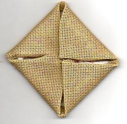 needlepoint folded to diamond shape
