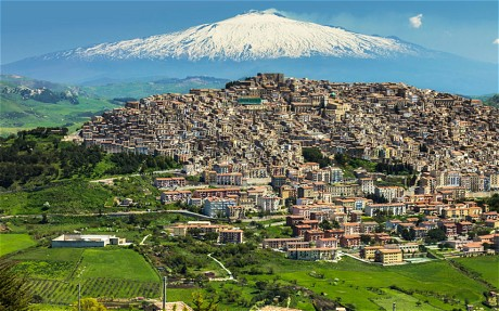 Gangi with Mt. Etna in the background. Alamy