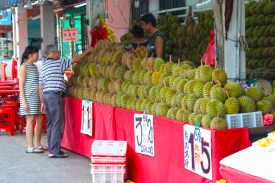 couple buying Durian. Hope they're not taking the metro!