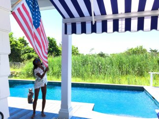 Behind the scenes. Fixing the flag for Sophie to have the perfect shot.
