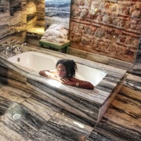 In Marble Bathtub by Nneya Richards