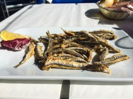 my favorite Italian beachside meal. LIGHTLY fried anchovies.