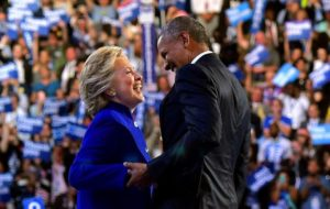 US President Barack Obama is joined by US Democratic presidential candidate Hillary Clinton after his address to the Democratic National Convention at the Wells Fargo Center in Philadelphia, Pennsylvania, July 27, 2016. / AFP PHOTO / Mandel NGANMANDEL NGAN/AFP/Getty Images