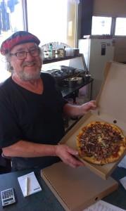 """Antonio"" (Anthony Larrington-Lewer) serves us up one of his last pizzas"