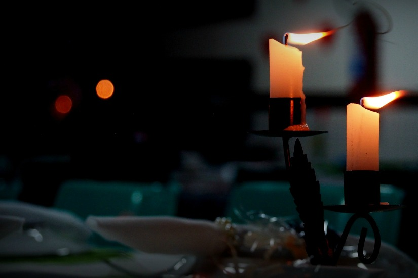 Shabbat and Sabbath observation with candles on a dinner table