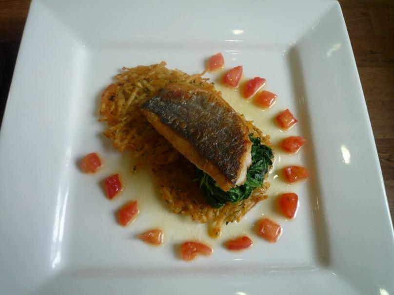 Exam Main: Pan fried sea bass on spinach and rosti potato.