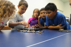 Our After School Program encourages children to improve their focus with chess.