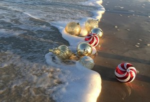 Christmas ornaments in the surf on the beach - naplesbonitamarco.com