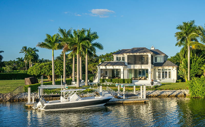waterfront house with dock and boat in Naples, Florida