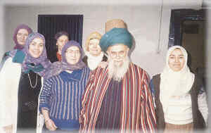Shaykh Nazim with his wife and two daughters (front) at their home in Cyprus. As a shaykh of the Mevlevi Order Shaykh Nazim is wearing the traditional turban that is its trademark, wrapped on the tall Mevlevi sikke.