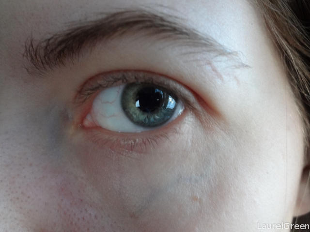 A close-up of a green eye.