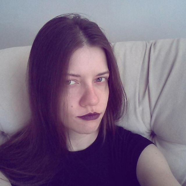 a photo of laurel green looking goth and being grumpy