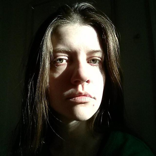 a high-contrast photo of laurel green looking bummed out
