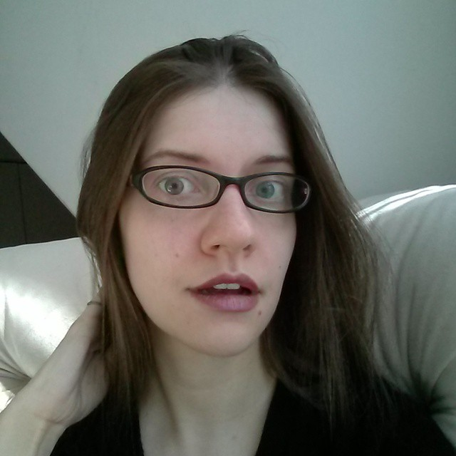 a photo of laurel green wearing glass with her mouth open