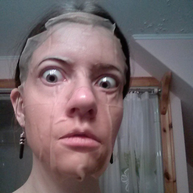 a closeup photo of laurel green wearing a face mask sheet