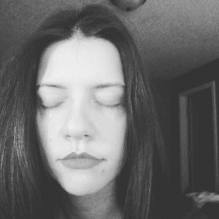 black and white photo of laurel green's face with her eyes closed