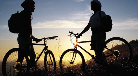 two_mountain_bikers_taking_a_rest_to_watch_sunset.jpg