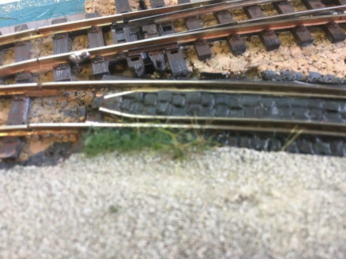Static grass in the Valdez-Lutran station yard embedded track