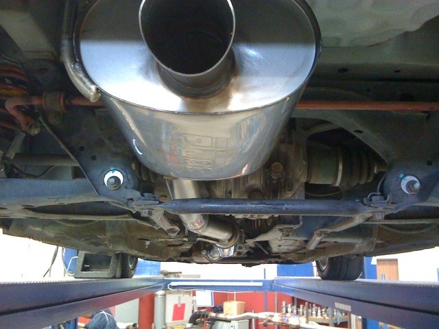 The new systems can be fitted with an auxiliary muffler at the rear for additional sound attenuation. The second muffler is tucked up and in far enough that it won't be damaged by bump drafting or incidental contact.