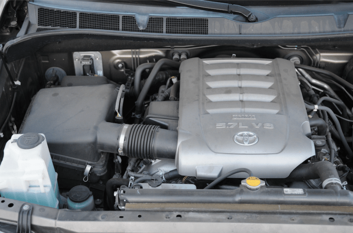 Begin by removing the engine cover, the stock air box and elbow, by unfastening the clips that hold the top of the air box together.