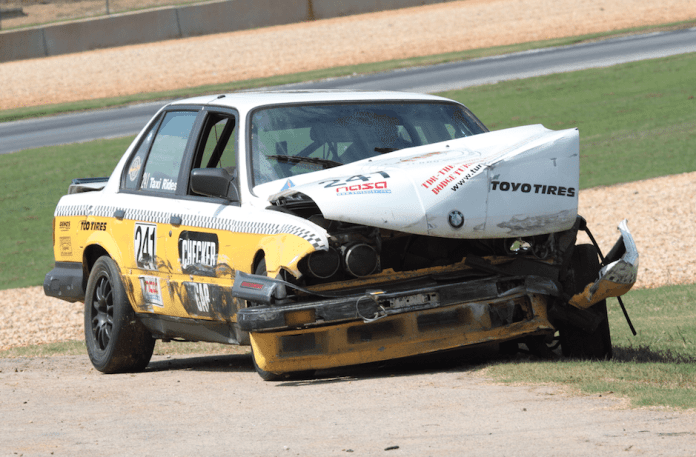 Call these before, during and after. Team Patton's Checker Cab-themed Spec E30 was punted into a wall heading into the 10A chicane. This one likely won't buff out.