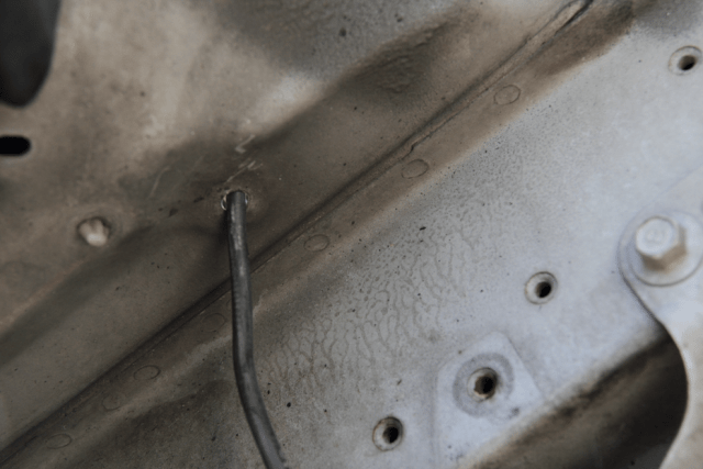 Run the power cord into the engine bay through an existing hole. No sense drilling if you don't have to.