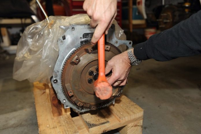 Find a socket that is the same diameter as the outer race on the pilot bearing and gently tap it into place with a mallet. Don't just wail away at it with the mallet. You can damage the bearing that way.