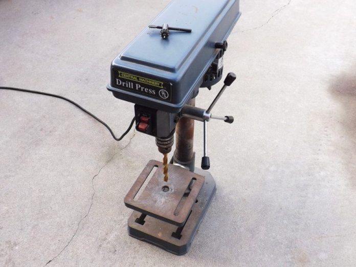 A good drill press is your friend. Even a cheap one from Harbor Freight beats a handheld drill. This will come in handy when you are trying to drill multiple plates of weight to insert a single grade-5 bolt through.