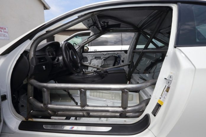 The E92 cage is fitted with NASCAR bars on the driver's side. They protrude into the door to give the driver extra protection in the event of a perpendicular collision.