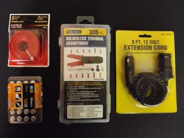 A trip to Harbor Freight will supply you with some solderless connectors, wire, a 12-volt extension cord (you will use the female end), and a bunch of AA batteries. Total cost: around $14.