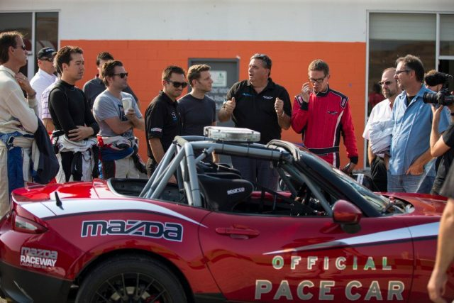 Tom and Glenn Long go over the highlights of the new Global MX-5 Cup car for a group of journalists.