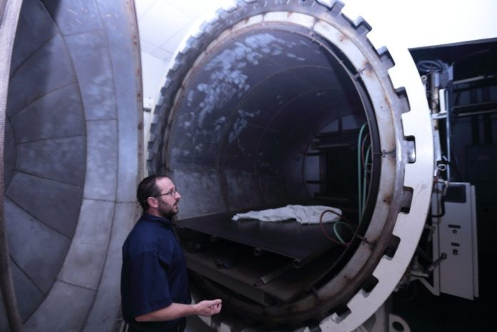 Élan inventory and logistics manager Darren Hurst explains that after lamination and vacuum bagging, the doors, roof and splitter are heated in an autoclave at Élan's facility.