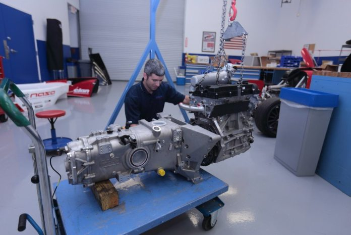 The transaxle also houses the reservoir for the engine's dry-sump oiling system.