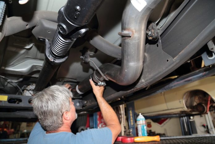 "By bolting the flange to the catalytic converter, you use the forward pipe to ""orient"" the intermediate pipe in front of the muffler on its hangers."