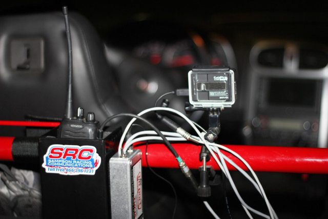 Looking for a solid and safe place to mount a heavy fire extinguisher, we decided to mount it to a harness bar. This bar also holds a GoPro camera connected to an I/O Port TVC15 radio-camera interface, and a Sampson Racing Communications radio box.
