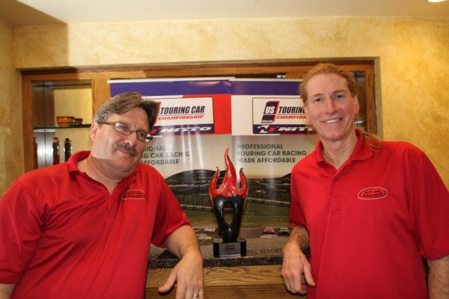 Karl Chicca and Beau Borders finished in second place overall in the Touring Class. Accepting the award was Chris Hovey (left) and Gary Ginger (right).