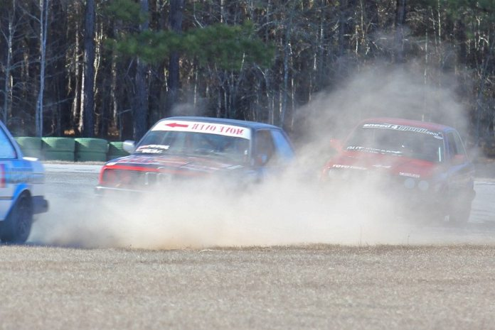 Rob Eskew slides off Carolina Motorsport Park's Turn 14 and gets some dirt. Scott Gress and Craig Guthrie are looking to pounce.