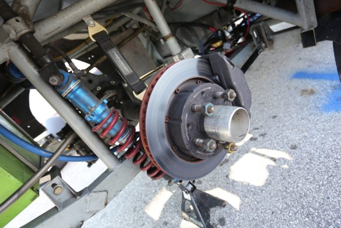 For a car with a live axle, it is possible to take advantage of the modest flexibility of the axle shafts, or barrel-shaped splines on their inboard ends, to build an axle with camber, toe, or a combination of both.
