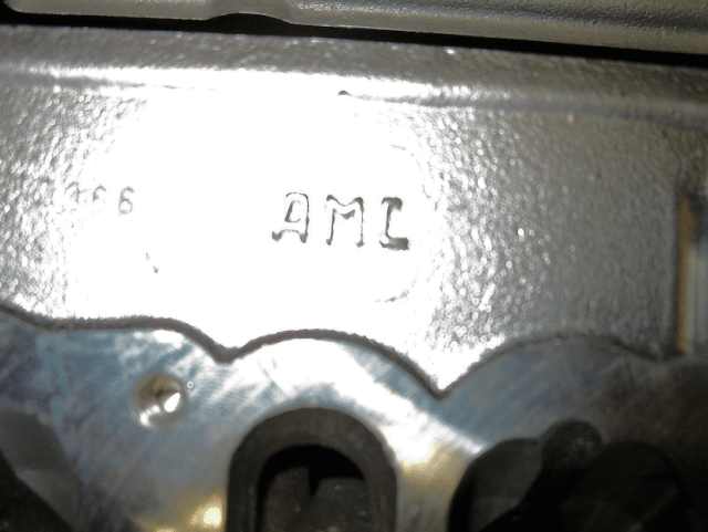 """Manufactured in Spain, aftermarket heads from AMC are identifiable by the """"AMC"""" cast into the back of the head behind the intake manifold (inset). They differ from OEM heads in that the intake ports are of larger volume and the valve guides are recessed deeper into the throat."""